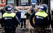 Boze demonstranten tegen het overheidsbeleid op het Museumplein op 17 Januari van dit jaar. Burgers laten de laatste twee decennia hun woede steeds meer blijken.